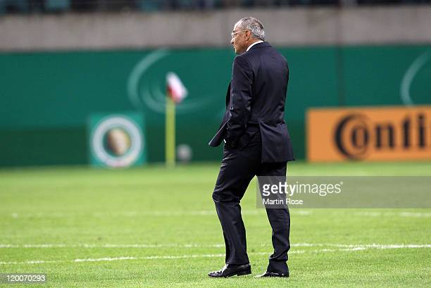 Felix Magath, head coach of Wolfsburg walks off dejected after the DFB Cup first round match between RB Leipzig and VfL Wolfsburg at the Red Bull...