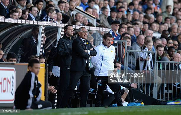 Felix Magath Manager of Fulham encourages his players as John Carver of Newcastle United looks on during the Barclays Premier League match between...