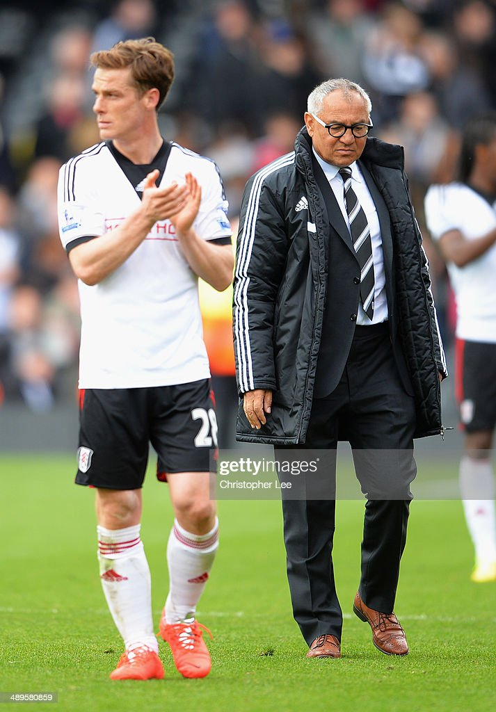 Felix Magath, manager of Fulham looks dejected with Scott Parker after the Barclays Premier League match between Fulham and Crystal Palace at Craven Cottage on May 11, 2014 in London, England.