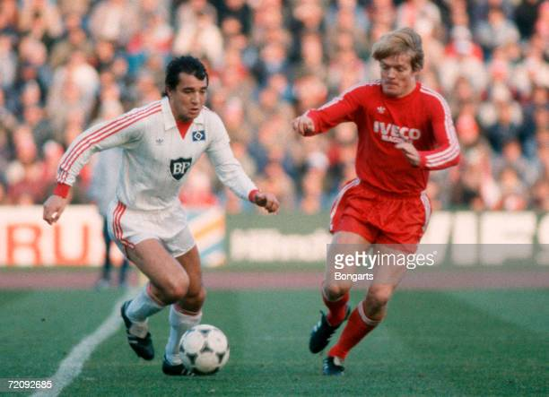 Felix Magath of Hamburg and Soeren Lerby of Bayern battle for the ball during the Bundesliga match between Bayern Munich and Hamburger SV at the...