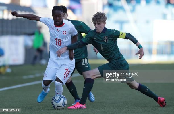 Felix Mambimbi of Switzerland is challenged by Nicolo Rovella of Italy during the International Friendly match between Italy U19 and Switzerland U19...