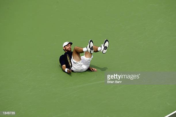 Felix Mantilla of Spain falls to the hardcourt after missing a shot to the corner from Greg Rusedski of Great Britain during the finals of the RCA...