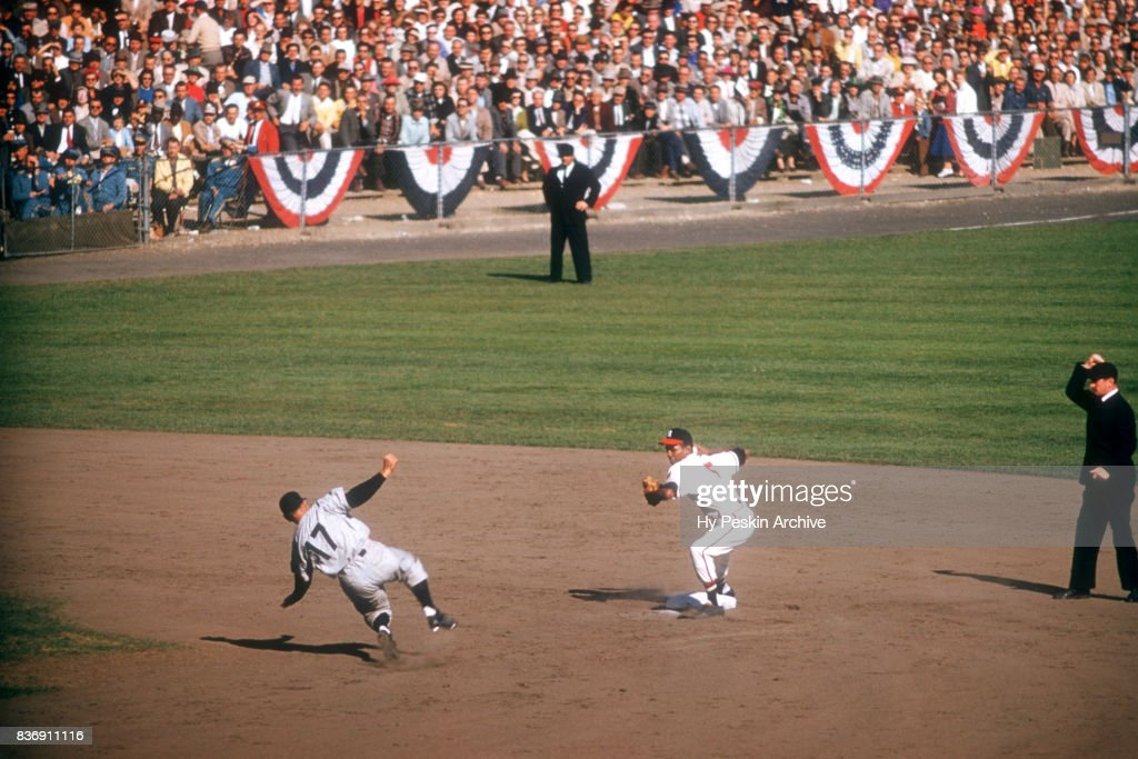 Felix Mantilla #5 of the Milwaukee Braves throws to first as Enos Slaughter #17 of the New York Yankees slides into second base during Game 5 of the 1957 World Series on October 7, 1957 at Milwaukee County Stadium in Milwaukee, Wisconsin.