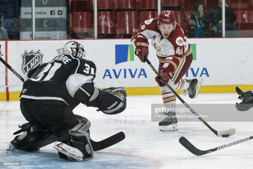 Felix Meunier #44 of the Acadie-Bathurst Titan shoots the puck against Mathieu Bellemare #31 of the Gatineau Olympiques on October 18, 2017 at Robert Guertin Arena in Gatineau, Quebec, Canada.
