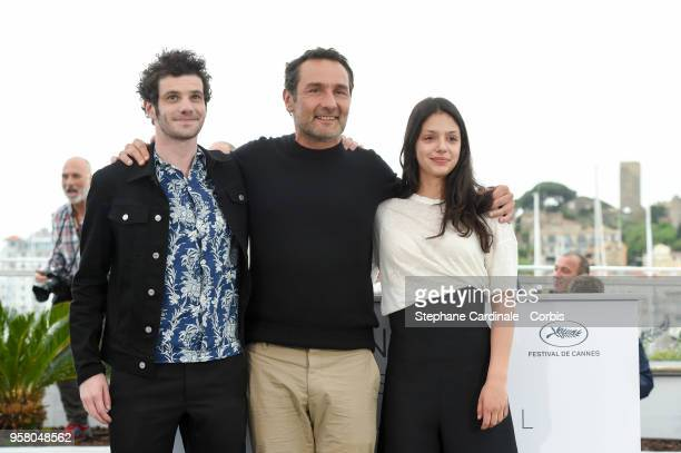 Felix Moati Gilles Lellouche and Noee Abita attend the Sink Or Swim Photocall during the 71st annual Cannes Film Festival at Palais des Festivals on...