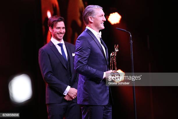 Felix Neureuther and Bastian Schweinsteiger during the Bambi Awards 2016 show at Stage Theater on November 17 2016 in Berlin Germany