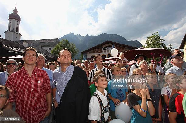 Felix Neureuther and supporters of the Munich bid look dejected after realizing the result that Munich looses their bid to become the host city of...