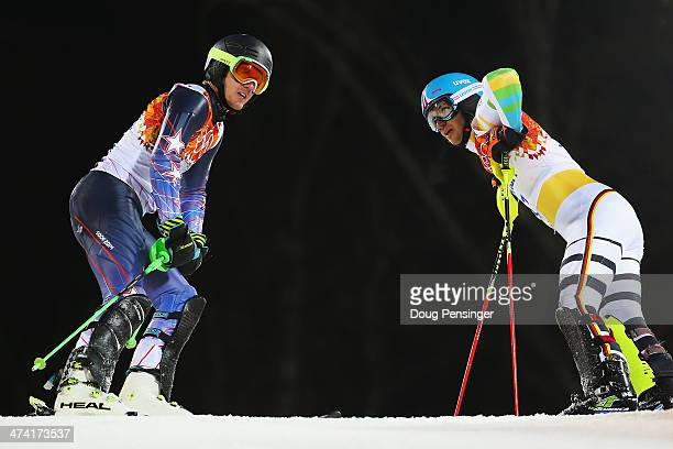 Felix Neureuther of Germany and Ted Ligety of the United States react after both crashing out in the second run during the Men's Slalom during day 15...