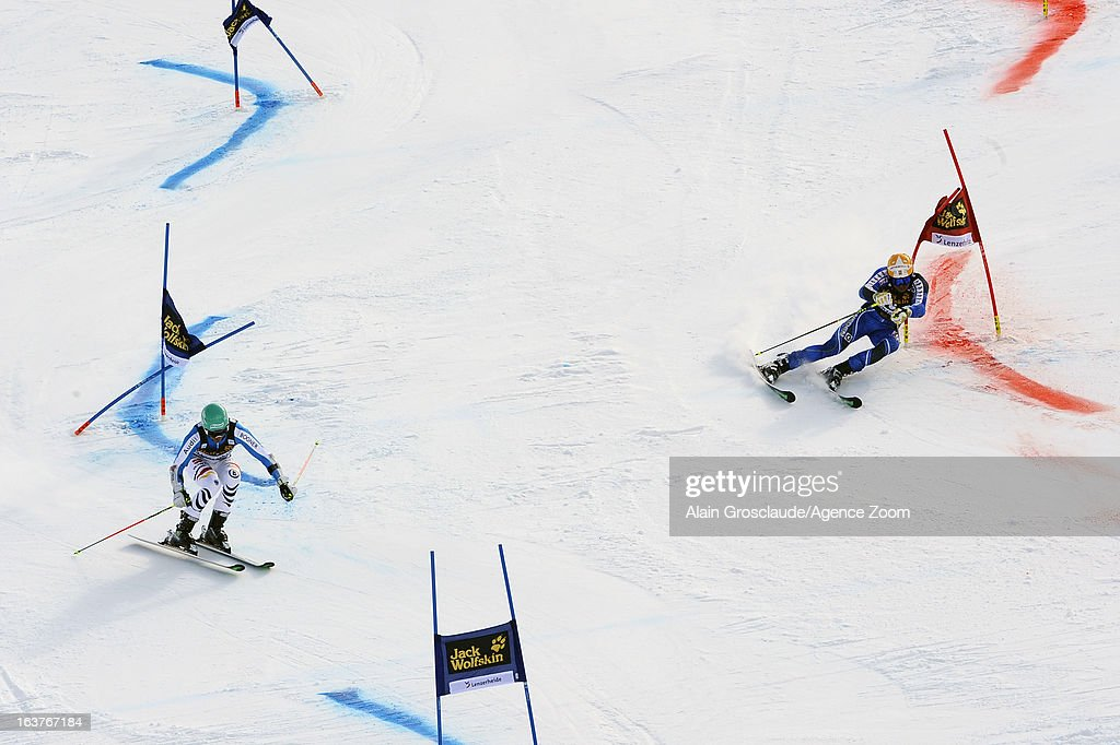 Felix Neureuther of Germany competes against Andre Myhrer of Sweden during the Audi FIS Alpine Ski World Cup Nation's Team event on March 15, 2013 in Lenzerheide, Switzerland.
