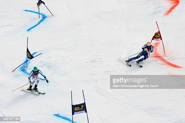Felix Neureuther of Germany competes against Andre Myhrer of Sweden during the Audi FIS Alpine Ski World Cup Nation's Team event on March 15 2013 in...