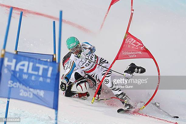 Felix Neureuther of Germany is hit by by Filip Zubcic of Croatia as he competes in the team event of the Alpine FIS Ski World Championships on...