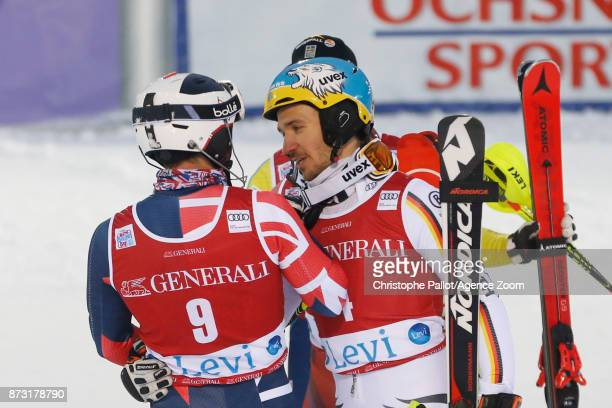 Felix Neureuther of Germany takes 1st place with Dave Ryding of Great Britain during the Audi FIS Alpine Ski World Cup Men's Slalom on November 12...