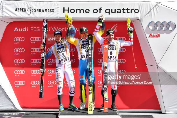Felix Neureuther of Germany takes 2nd place Andre Myhrer of Sweden takes 1st place Michael Matt of Austria takes 3rd place during the Audi FIS Alpine...