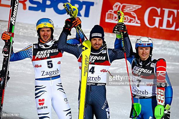 Felix Neureuther of Germany takes 2nd place Manfred Moelgg of Italy takes 1st place Henrik Kristoffersen of Norway takes 3rd place during the Audi...