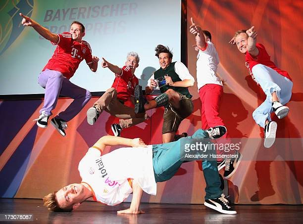 Felix Neureuther performes with the dancefloor destructions crew dancers after the Bavarian Sport Award gala at BMW Welt on July 6 2013 in Munich...
