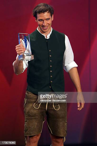 Felix Neureuther receives the Bavarian Sportaward 2013 during the Bavarian Sport Award gala at BMW Welt on July 6 2013 in Munich Germany