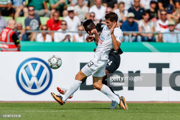 Felix Nierichlo of SSV Ulm and Danny da Costa of Eintracht Frankfurt battle for the ball during the DFB Cup first round match between SSV Ulm 1846...