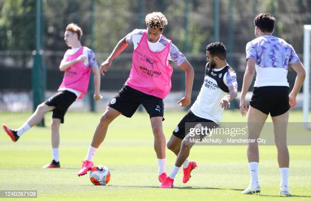 Felix Nmecha and Riyad Mahrez of Manchester City in action during the training session at Manchester City Football Academy on June 01 2020 in...