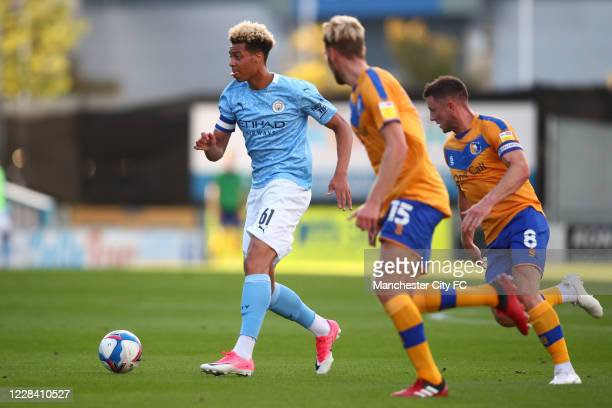 Felix Nmecha of Manchester City in action with Aaron O'Driscoll and Ollie Clarke of Mansfield Town during the EFL Trophy match between Mansfield Town...