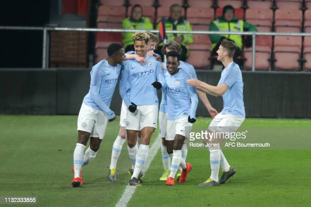 Felix Nmecha of Manchester City is congratulated by teammates after he scores a goal to make it 10 during the FA Youth Cup match between AFC...