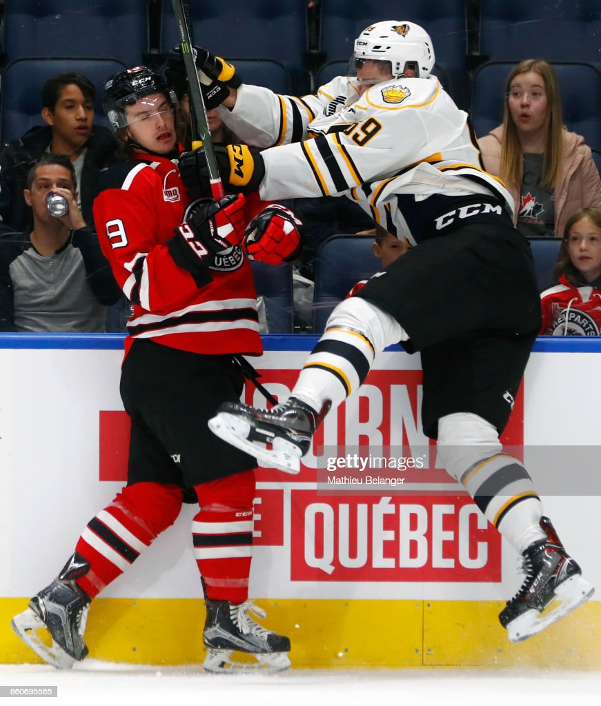 Felix Pare #89 of the Victoriaville Tigres hits Jeremy Laframboise #19 of the Quebec Remparts during the first period of their QMJHL hockey game at the Centre Videotron on October 12, 2017 in Quebec City, Quebec, Canada.