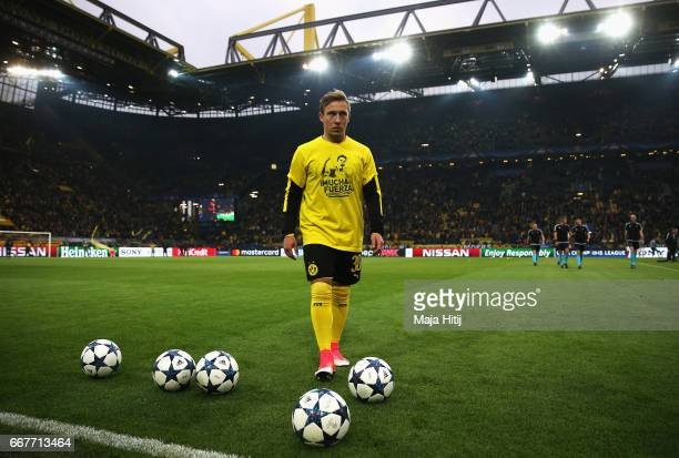 Felix Passlack of Borussia Dortmund wears a shirt for Marc Bartra who was injured in the team coach attack prior to the UEFA Champions League Quarter...