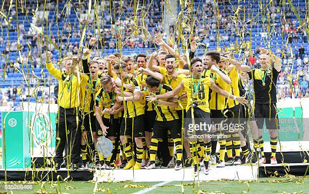 Felix Passlack of Dortmund drops the trophy as team mates of Dortmund celebrate after the A Juniors German Championship Final match between 1899...