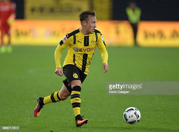 Felix Passlack of Dortmund handles the ball during the friendly match between AFC Sunderland v Borussia Dortmund at Cashpoint Arena on August 5 2016...