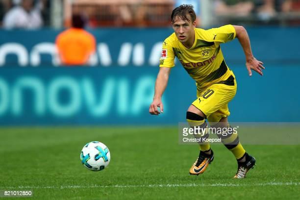 Felix Passlack of Dortmund runs with the ball during the preseason friendly match between VfL Bochum and Borussia Dortmund at Vonovia Ruhrstadion on...