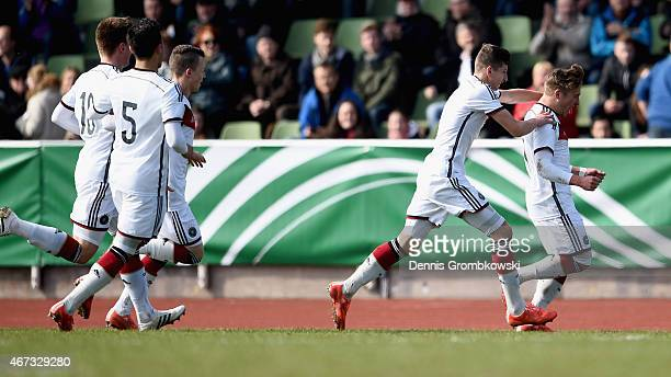 Felix Passlack of Germany celebrates as he scores the opening goal during the UEFA Under 17 Elite Round match between Germany and Ukraine at...