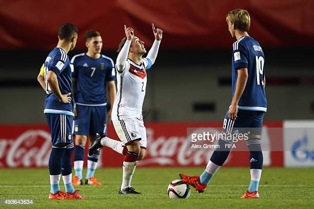 Felix Passlack of Germany celebrates his team's third goal as Tomas Conechny Gianluca Mancuso and Matias Roskopf of Argentina react during the FIFA...