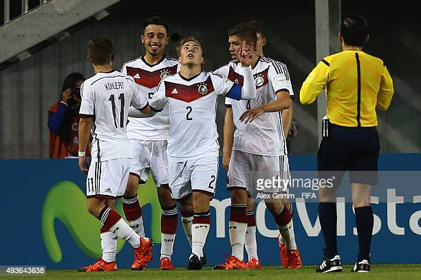 Felix Passlack of Germany celebrates his team's third goal with team mates during the FIFA U17 World Cup Chile 2015 Group C match between Argentina...