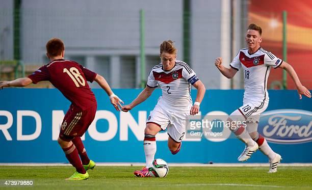 Felix Passlack of Germany U17 challenges Amir Gavrilov of Russia U17 during the UEFA European Under17 Championship Semi Final match between Germany...