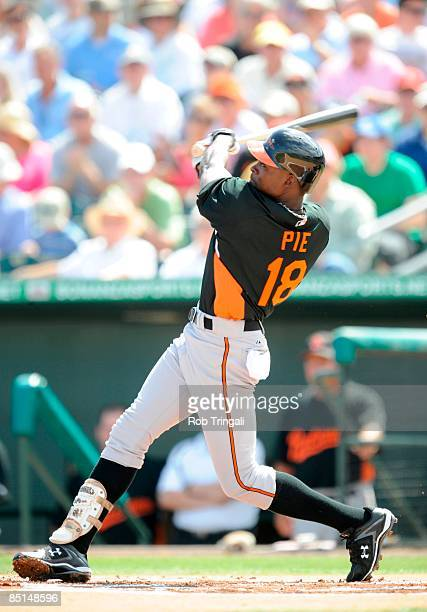 Felix Pie of the Baltimore Orioles bats against the Florida Marlins during a spring training game at Roger Dean Stadium on February 27 2009 in...