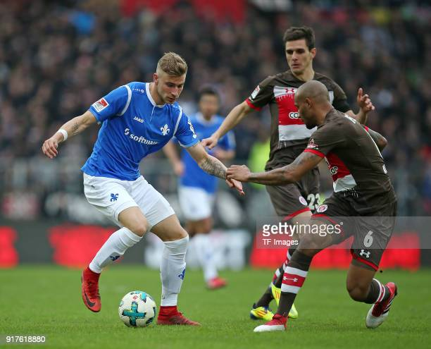 Felix Platte of Darmstadt Johannes Flum of St Pauli and Christopher Avevor of St Pauli battle for the ball during the Second Bundesliga match between...