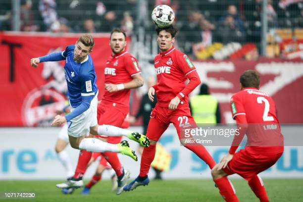 Felix Platte of Darmstadt jumps for a header with Jorge Mere of Koeln during the Second Bundesliga match between SV Darmstadt 98 and 1 FC Koeln at...