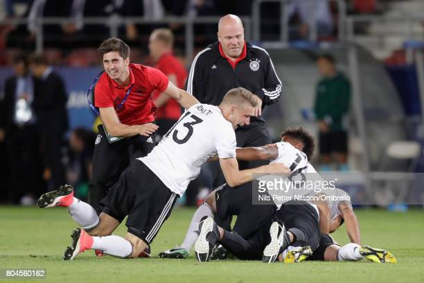 Felix Platte of Germany and Thilo Kehrer of Germany celebrate victory with their team mates and coaches during the UEFA European Under21 Championship...