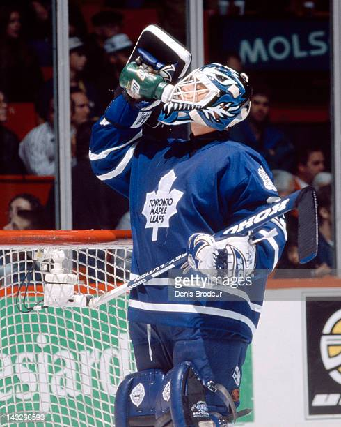 Felix Potvin of the Toronto Maple Leafs drinks water during a break in the action Circa 1993 at the Montreal Forum in Montreal Quebec Canada