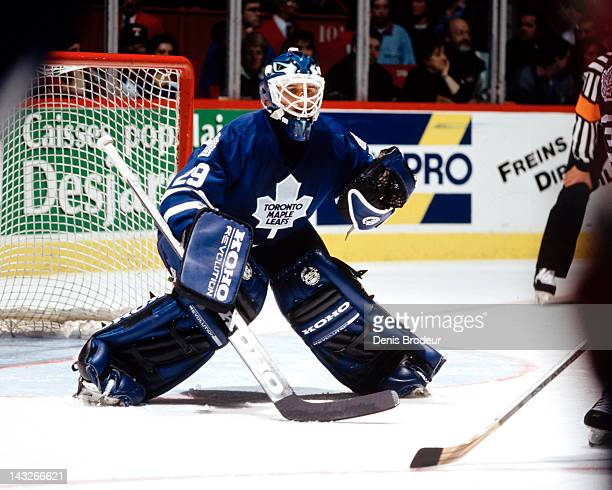 Felix Potvin of the Toronto Maple Leafs follows the action around the net during a game against the Montreal Canadiens Circa 1995 at the Montreal...