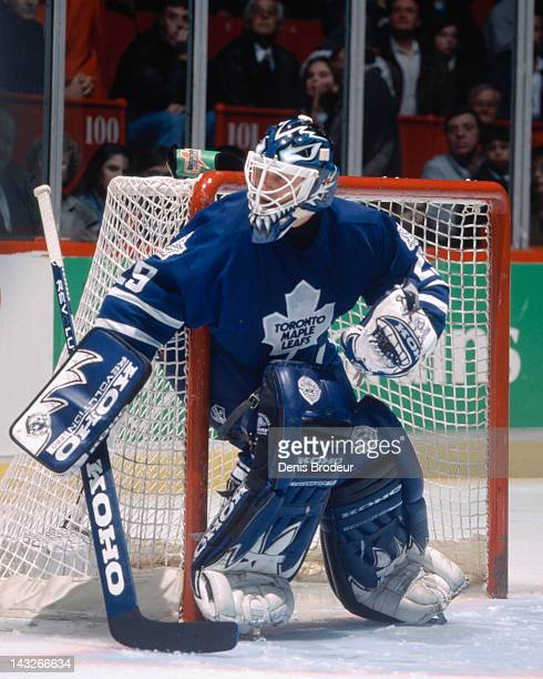 Felix Potvin of the Toronto Maple Leafs follows the action near the net during a game against the Montreal Canadiens Circa 1995 at the Montreal Forum...