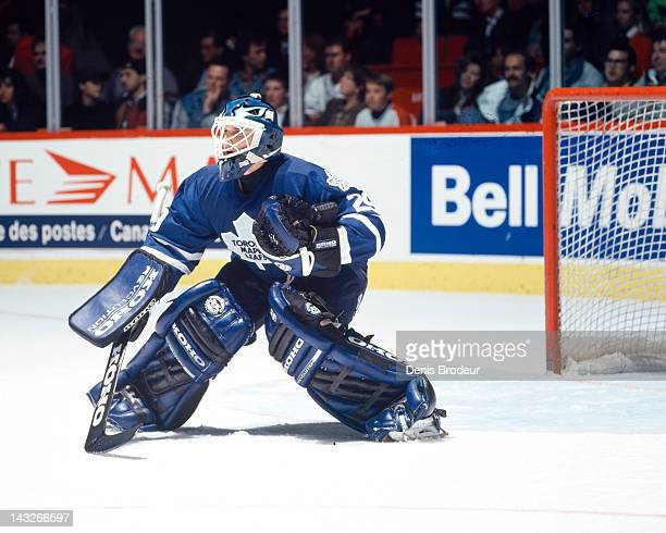 Felix Potvin of the Toronto Maple Leafs keeps his eye on the puck as the play comes towards the Toronto Maple Leafs zone during a game against the...