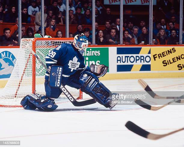 Felix Potvin of the Toronto Maple Leafs makes a glove save during a game against the Montreal Canadiens Circa 1993 at the Montreal Forum in Montreal...