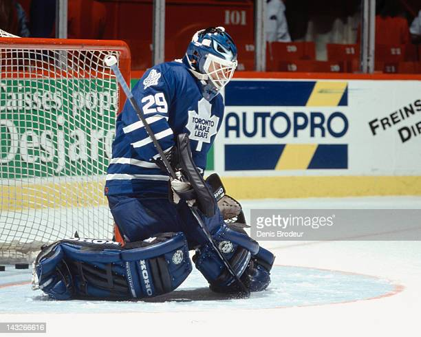 Felix Potvin of the Toronto Maple Leafs makes a save during a game against the Montreal Canadiens Circa 1995 at the Montreal Forum in Montreal Quebec...