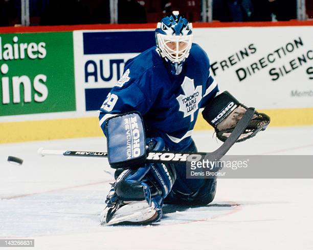 Felix Potvin of the Toronto Maple Leafs makes a save during a game against the Montreal Canadiens Circa 1993 at the Montreal Forum in Montreal Quebec...