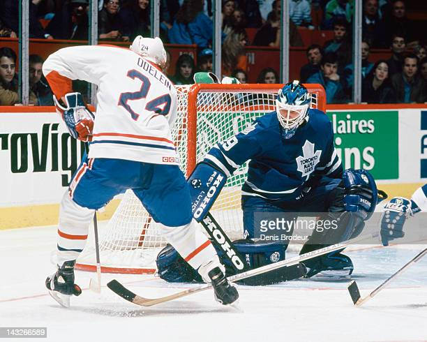 Felix Potvin of the Toronto Maple Leafs makes a save on Lyle Odelein of the Montreal Canadiens near the net Circa 1993 at the Montreal Forum in...