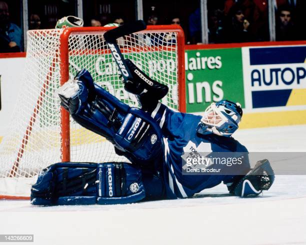 Felix Potvin of the Toronto Maple Leafs slides to make a save during a game against the Montreal Canadiens Circa 1993 at the Montreal Forum in...