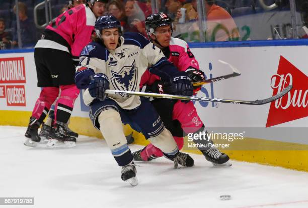 Felix Robert of the Sherbrooke Phoenix and LouisFilip Cote of the Quebec Remparts battle for the puck during the third period of their QMJHL hockey...