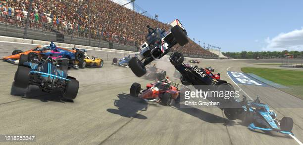 Felix Rosenqvist driver of the NTT Data Chip Ganassi Racing Honda crashes during the IndyCar iRacing Challenge Chevrolet 275 at virtual Michigan...