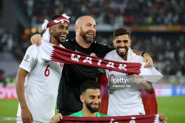 Felix Sanchez Manager of Qatar celebrate with Abdelaziz Hatim Hasan Al Haydos and Saad Al Sheeb of Qatar following their sides victory in the AFC...