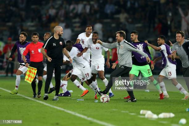 Felix Sanchez Manager of Qatar celebrates with his backroom staff and players of Qatar at the final whistle following their sides victory in the AFC...